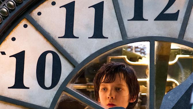 "In this image released by Paramount Pictures, Asa Butterfield portrays Hugo Cabret in a scene from ""Hugo.""  The film was nominated Tuesday, Jan. 24, 2012 for an Oscar for best film. The Oscars will be presented Feb. 26 at the Kodak Theatre in Los Angeles, hosted by Billy Crystal and broadcast live on ABC. (AP Photo/Paramount Pictures, Jaap Buitendijk)"