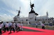 This file photo shows Philippine President Benigno Aquino and government officials arriving to inspect a warship, in Manila, on August 23, 2011. Aquino vowed on Monday to acquire fighter jets, air defence radar and other equipment within three years to bolster the country's weak air force, amid a territorial dispute with China