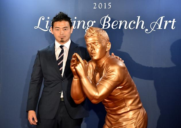 Japan's Rugby World Cup star Ayumu Goromaru unveils his life-size bronze statue during a ceremony in Tokyo on November 30, 2015