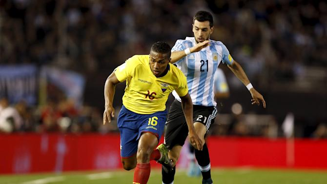 Ecuador's Antonio Valencia competes for the ball with Argentina's Javier Pastore during their 2018 World Cup qualifying soccer match at the Antonio Vespucio Liberti stadium in Buenos Aires