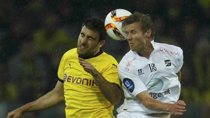 Dortmund's Papastathopoulos and Odd Grenland BK's Flo jump for a header during their Europa League play-off soccer match in Dortmund