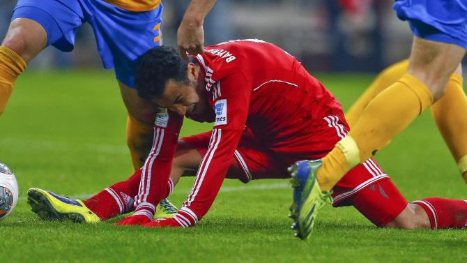 Braunschweig's Bicakcic challenges Bayern Munich's Thiago during their German first division Bundesliga soccer match in Munich