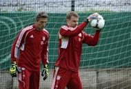 Bayern Munich goalkeepers Manuel Neuer (R) and Rouven Sattelmaier during a training session in Berlin on May 11. The Bavarians host the Champions League final against Chelsea on May 19 and while they could be forgiven for being distracted, Neuer insists all eyes are on Berlin