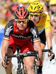 Australia's Cadel Evans (L) and Britain's Bradley Wiggins (R) rides to the finish line at the end of the eighth stage of the Tour de France starting in Belfort and finishing in Porrentruy on July 8. The pair are likely to leave many of those same rivals further in their wake after Monday's 41.5 km time trial in Besancon, one of two long time trials this year