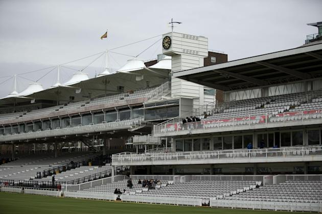 The famous weather vane above the clock of the Mound Stand at Lord's Cricket ground is seen bent over in London, Monday, March 30, 2015.  The weather vane depicting Father Time was bent over by st