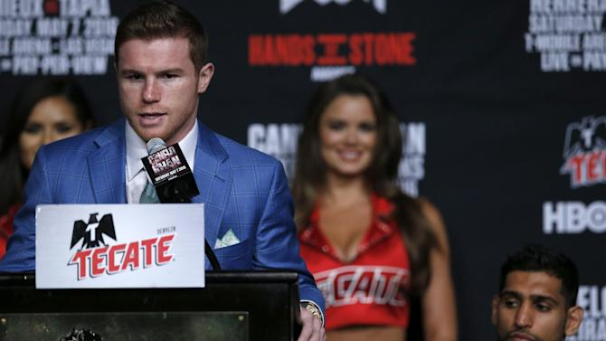 Saul 'Canelo' Alvarez during the press conference as Amir Khan looks on