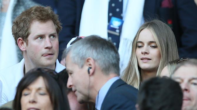 Britain's Prince Harry with his girlfriend Cressida Bonas attend the Six Nations Rugby Union match between England and Wales at Twickenham stadium in London Sunday March, 9, 2014. (AP Photo/Alastair Grant)