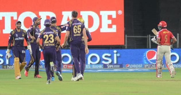 Pune: Kolkata Knight Riders celebrate fall of a wicket during an IPL-2015 match between Kolkata Knight Riders and Kings XI Punjab at Maharashtra Cricket Association Stadium, in Pune, on April 18, 2015