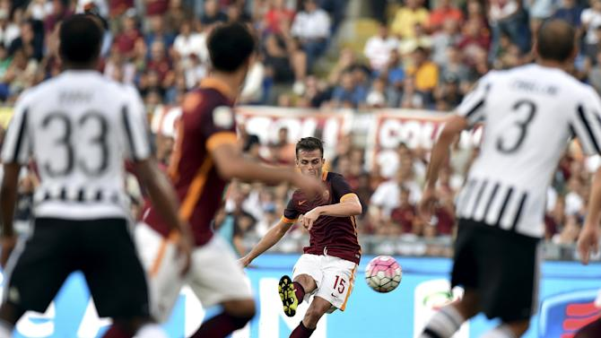 AS Roma's Pjanic shoots a free kick and scores against Juventus during their Serie A soccer match at Olympic stadium in Rome