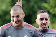 Franck Ribery (R) and Karim Benzema, pictured at a France training session at Clairefontaine in 2011. Bayern Munich have given their backing to Ribery, after he and compatriot Karim Benzema were sent for trial for allegedly soliciting an under-age prostitute