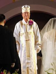 Sun Myung Moon blesses couples during a mass wedding ceremony in Seoul in 2002. Revered by his followers but denounced by critics as a cult-building charlatan, Moon was a deeply divisive figure whose shadowy business and financial dealings saw him jailed in the US
