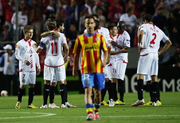 Sevilla's players celebrate winning after the end of their soccer match against Valencia in Seville