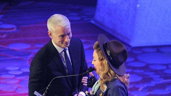 Madonna presents CNN news anchor Anderson Cooper with the Vito Russo Award at the 24th Annual GLAAD Media Awards at the Marriott Marquis on Saturday March 16, 2013 in New York. Madonna presented CNN news anchor Anderson Cooper with the Vito Russo Award. (Photo by Evan Agostini/Invision/AP)