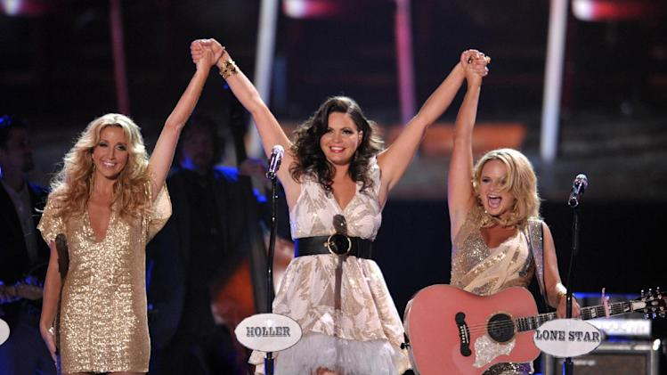 "FILE - This June 2, 2012 file photo shows, from left, Ashley Monroe, Angaleena Presley and Miranda Lambert of Pistol Annies at the 2012 CMT Music Awards in Nashville, Tenn.  The female group released their new album, ""Annie Up,"" on Tuesday. (Photo by John Shearer/Invision/AP, file)"