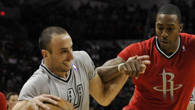 San Antonio Spurs guard Manu Ginobili, left, of Argentina, drives around Houston Rockets forward Dwight Howard during the first half of an NBA basketball game Wednesday, Dec. 25, 2013, in San Antonio