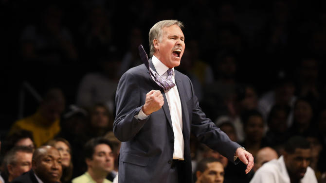 Los Angeles Lakers head coach Mike D'Antoni reacts in the second half of an NBA basketball game against the Brooklyn Nets at the Barclays Center, Wednesday, Nov. 27, 2013, in New York. The Lakers defeated the Nets 99-94