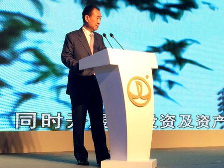 Wang Jianlin, chairman of Dalian Wanda Group, speaks during a news conference in Beijing