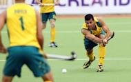 File photo shows Australia's Christopher Ciriello (R) at the Champions Trophy tournament in Auckland in December 2011. Australian men's field hockey team head coach Ric Charlesworth says his world number one side have been disadvantaged by an unfair draw at the London Olympics