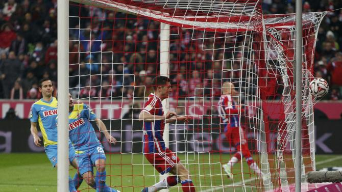 Bayern Munich's Lewandowski scores against FC Cologne during Bundesliga soccer match in Munich