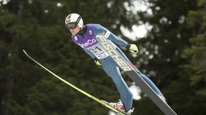 Miroslav Dvorak of Czech Republic soars through the air during the WC Nordic combined competition in Trondheim