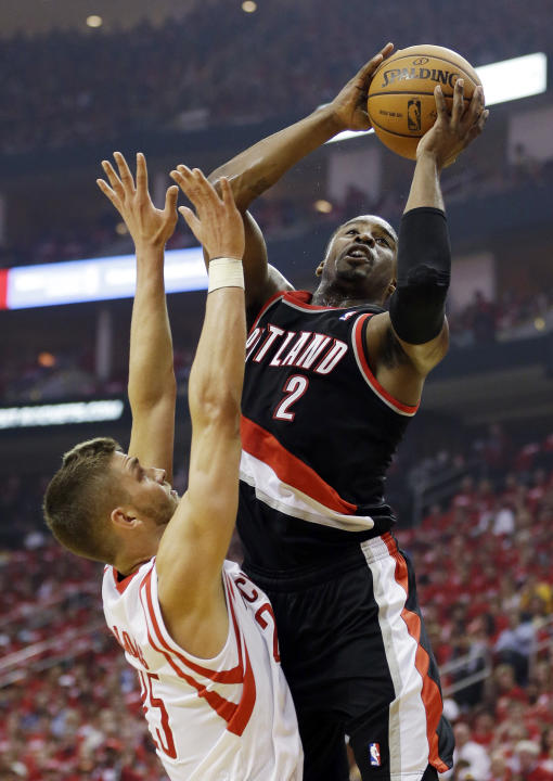 Portland Trail Blazers' Wesley Matthews (2) shoots over Houston Rockets' Chandler Parsons during the first half in Game 1 of an opening-round NBA basketball playoff series, Sunday, April 20, 2