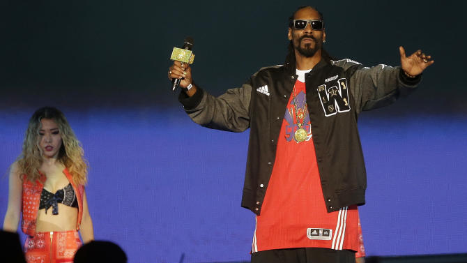 Rapper Snoop Dog performs before the NBA All Star basketball game, Sunday, Feb. 16, 2014, in New Orleans