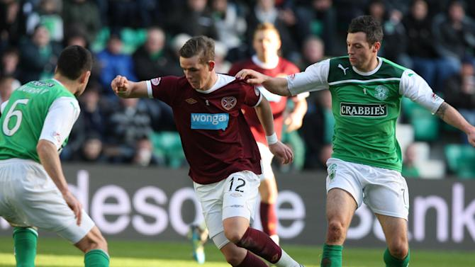 David Templeton, centre, is determined to shine consistently for Hearts this season