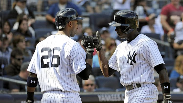 New York Yankees' Alfonso Soriano, right, celebrates with Eduardo Nunez after Soriano hit a home run during the sixth inning of an inter-league baseball game Saturday, Sept. 21, 2013, at Yankee Stadium in New York. The Yankees won 6-0