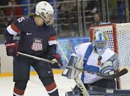 Alex Carpenter of the US tries to score against Finland's goalkeeper Noora Raty during the Women's Ice Hockey Group A match at the Shayba Arena during the Sochi Winter Olympics on February 8, 2014