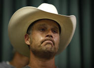 "Tyson Houston, nephew of Cliven Bundy, cries after speaking at a public meeting in the Moapa Valley Community Center in Overton, Nev. Wednesday, April 9, 2014. The meeting was about the roundup by the Bureau of Land Management's roundup of what they call ""trespass cattle"" run by Cliven Bundy in the Gold Butte area 80 miles northeast of Las Vegas. (AP Photo/Las Vegas Review-Journal, John Locher)"