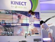 Photo illustration shows models demonstrating the new motion-sensor system for Xbox 360 videogame. Microsoft began testing whether a pricing strategy that has been a hit with smartphones will invigorate sales of its Xbox 360 videogame consoles