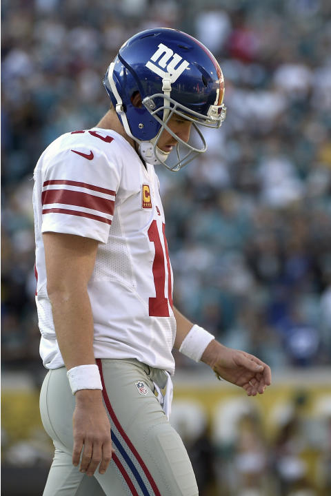 New York Giants quarterback Eli Manning (10) walks off the field after fumbling on their final possession of the second half of an NFL football game against the Jacksonville Jaguars in Jacksonville, F