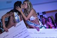 Andressa Urach (R) from Santa Catarina state and Camila Vernaglia from Sao Paulo state celebrate after finishing in 2nd and 3rd place during the Miss Bumbum pageant in Sao Paulo on November 30, 2012