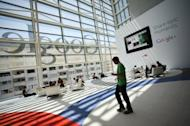 A Google logo is seen through windows of Moscone Center in San Francisco during Google's annual developer conference, in San Francisco on June 28