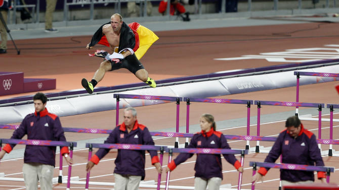 Germany's Robert Harting celebrates winning the men's discus throw final at London 2012 Olympic Games