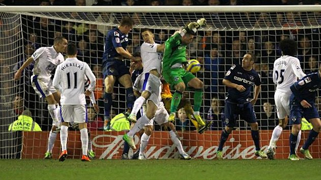Oldham Athletic's Matt Smith (centre left) scores his teams second goal of the game PA Photos Oldham v Everton