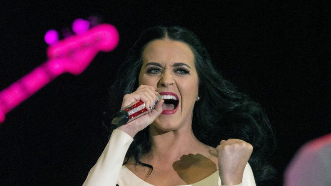 Singer Katy Perry performs for a crowd before the arrival of President Barack Obama at a campaign rally, Wednesday, Oct. 24, 2012, in Las Vegas. (AP Photo/Julie Jacobson)