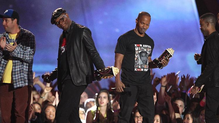 "Jamie Foxx, right, and Samuel L. Jackson accept the award for best WTF moment for ""Django Unchained"" at the MTV Movie Awards in Sony Pictures Studio Lot in Culver City, Calif., on Sunday April 14, 2013. (Photo by Matt Sayles/Invision /AP)"