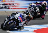 Yamaha Factory Racing team rider Jorge Lorenzo of Spain (front) and his compatriot, Power Electronics Aspar rider Aleix Espargaro, pictured in turn 11 during the qualifying practice at Mazda Raceway Laguna Seca in Monterey, California, on July 28. Lorenzo set a course record and will take the pole position ahead of Casey Stoner and Dani Pedrosa