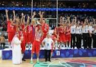 Iranian players celbrate with their trophy after defeating the Philippines in the men's Asia championship basketball final game in Manila on August 11, 2013. Iran routed the Philippines 85-71 to bag gold at the 27th FIBA Asian men's basketball championship on August 11