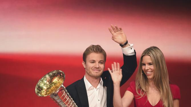 "Mercedes' Formula One World Champion Nico Rosberg and his wife Vivian during the ""Ein Herz fuer Kinder"" (A Heart for Children) TV charity telethon in Berlin"