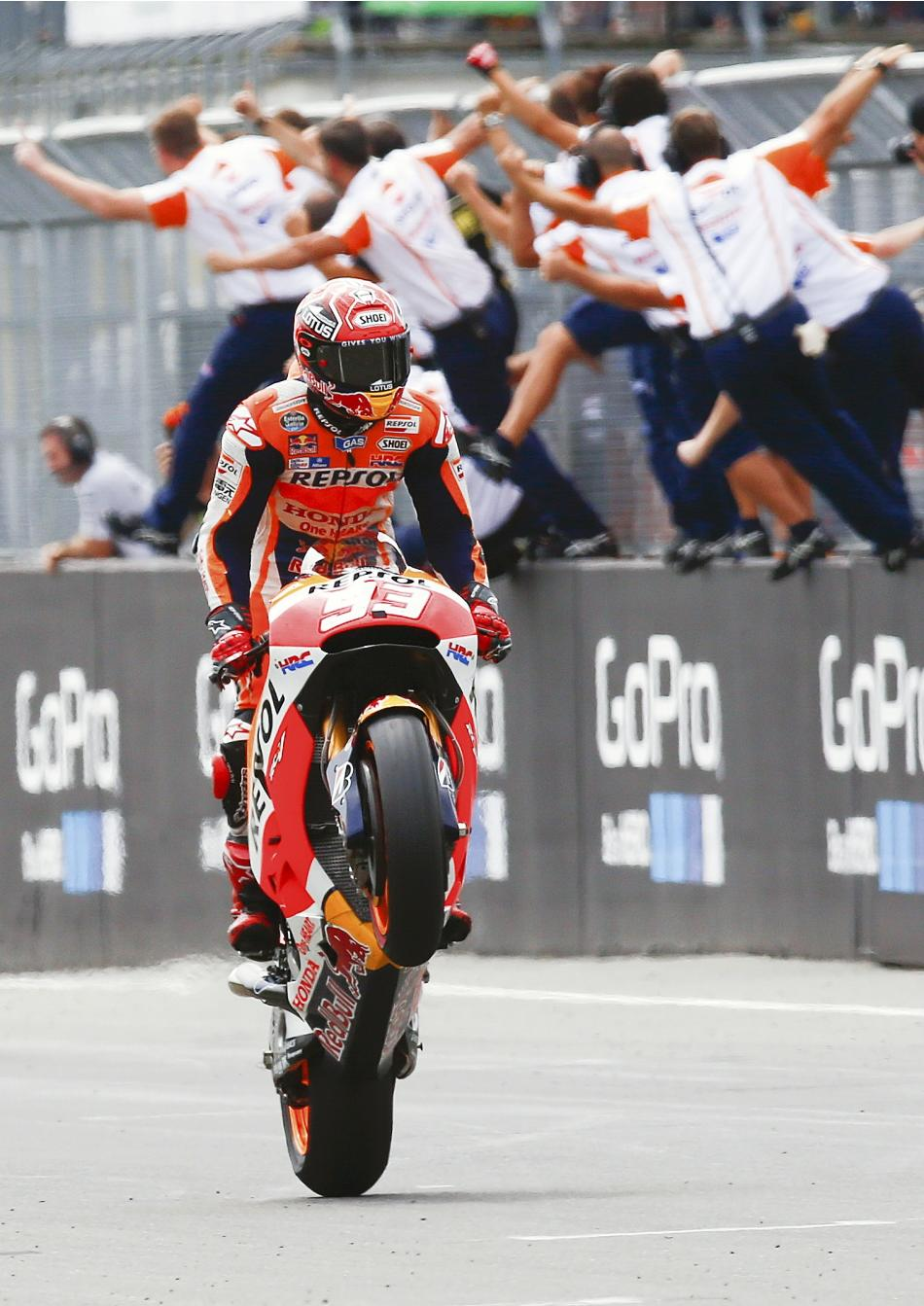Repsol Honda Team MotoGP rider Marquez of Spain celebrates after winning the German Grand Prix MotoGP at the Sachsenring circuit in the eastern town of Hohenstein-Ernstthal