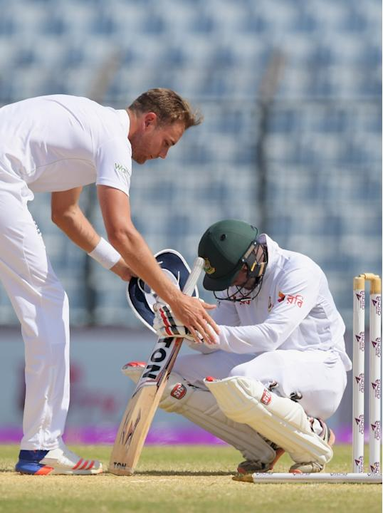 England's Stuart Broad (L) consoles Bangladesh's not-out batsman Sabbir Rahman after England took the final wicket to win the first Test on the final day's play in Chittagong on October 24