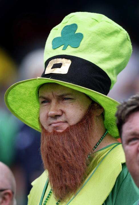 An Ireland supporter in costume stands before the start of the Cricket World Cup match between the team and South Africa in Canberra
