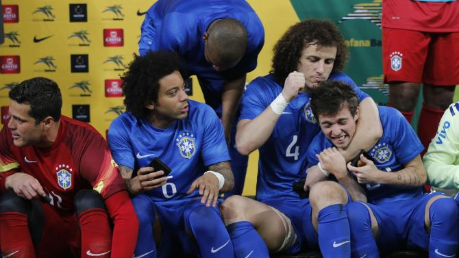 Brazil's Bernard jokes with David Luiz while Marcelo looks on at the end of their international friendly soccer match against South Africa at the First National Bank (FNB) Stadium, also known as Soccer City, Johannesburg