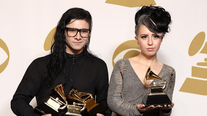 "Skrillex, left, winner of the awards for best dance/electronica album ""Bangarang,"" best remixed recording non-classical song for ""Promises"" and best dance recording ""Bangarang,"" and Sirah pose backstage with the award for best dance recording ""Bangarang,"" at the 55th annual Grammy Awards on Sunday, Feb. 10, 2013, in Los Angeles. (Photo by Matt Sayles/Invision/AP)"
