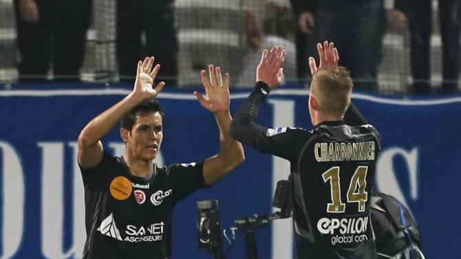 Reims players reacts after team mate O'Niangue scored against Olympique Marseille during their French Ligue 1 soccer match at the Velodrome stadium in Marseille