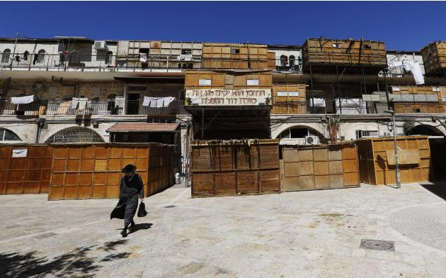 An ultra-Orthodox Jewish man walks near ritual booths in Jerusalem's Mea Shearim neighbourhood