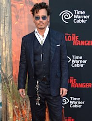 Johnny Depp scrubs up well in Ralph Lauren suit at Lone Ranger premiere