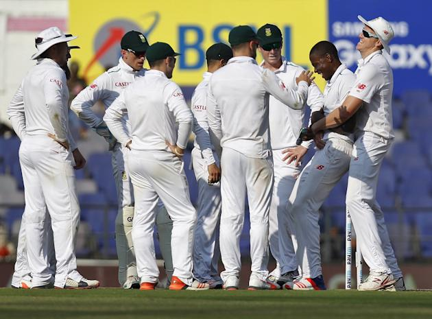 South Africa's Rabada celebrates with his teammates after dismissing India's Jadeja during the first day of their third test cricket match in Nagpur
